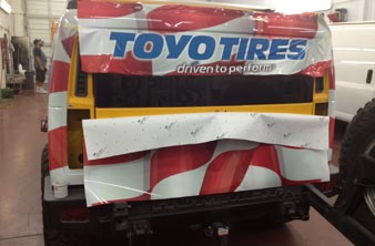 vehicle wrap install on a hummer